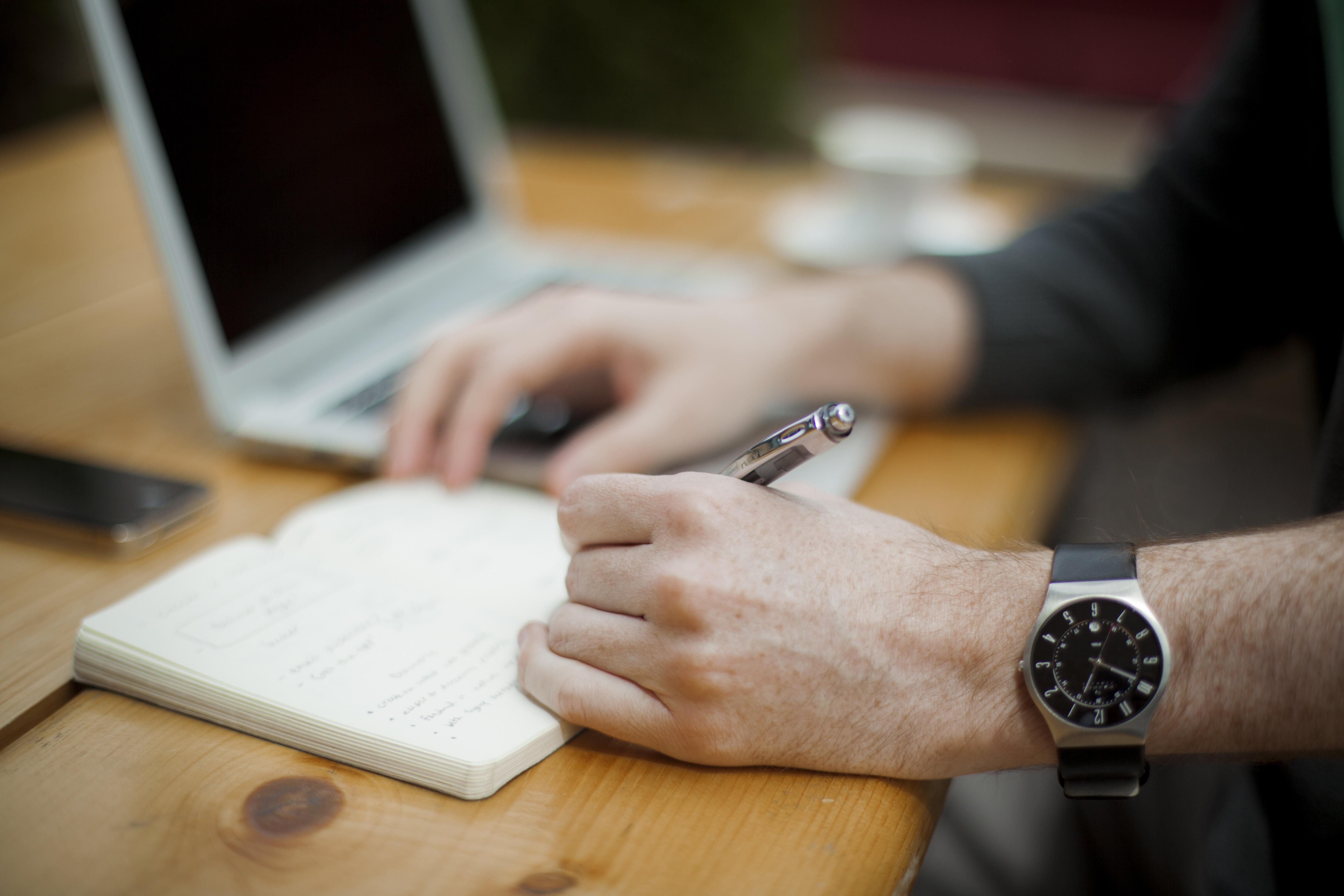 notebook-hands-writing.jpg